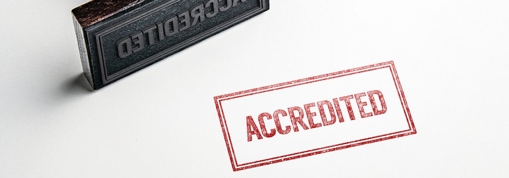 "stamp that says the word ""accredited"""