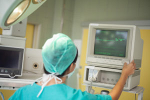 Surgical technician working on monitor