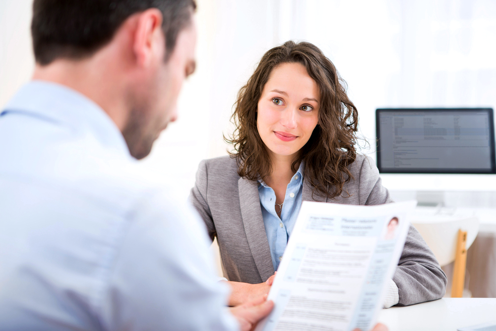 A young female interviews for a dental assisting position.