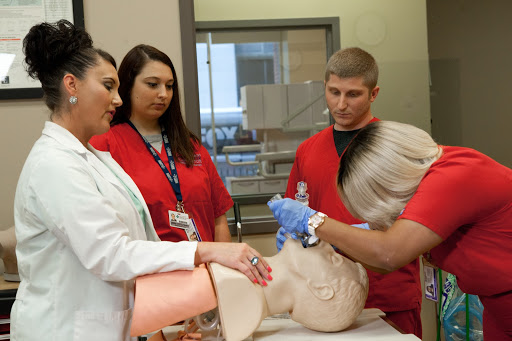 PCI students working with Respiratory Therapy instructor.