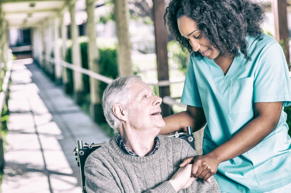Medical Assistant helping senior citizen
